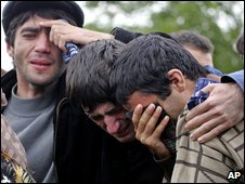 Relatives cry at the funeral of victims of the school siege in Beslan, 5 September 2004