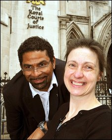 Debbie Purdy and husband Omar Puente outside the High Court in London