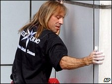 Alain Robert climbing a tower in Jakarta, Indonesia (25 July 2004)