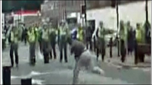 Youth throwing object at police