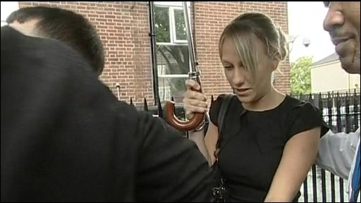 Chloe Madeley being escorted from court to a car