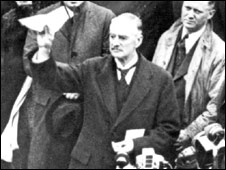 "Prime Minister Neville Chamberlain declaring ""peace for our time"""