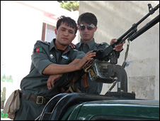 Two young police officers on election duty in Herat