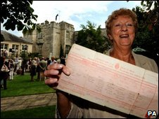 Hazel Hewitt, 69, from Norfolk, shows of her birth certificate during a garden party at Hazlewood Castle Hotel