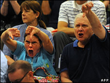 Opponents of healthcare reform show their displeasure at a town hall meeting in Reston, Virginia, 25 August 2009