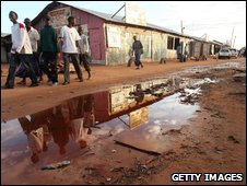 People walk down a street in Dadaab, Kenya