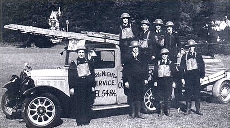 Group image showing the war-time converted fire engine and firemen