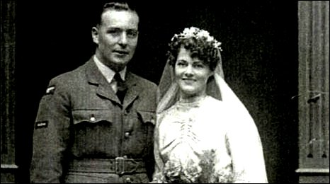 Image of Morgan Davies in uniform with his bride Edna Harris all in white
