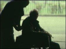 Man helping elderly person
