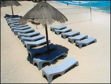 Empty sunbeds on beach