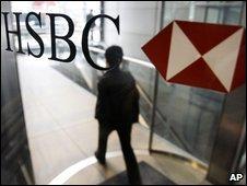 A man walks past HSBC's headquarters in Hong Kong