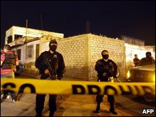 Police stand guard outside the drug treatment centre in Juarez