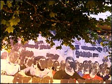 A defaced political mural in Ursubil