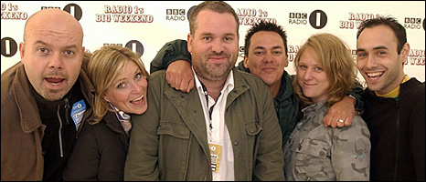 Chris Moyles (c) and his breakfast show team