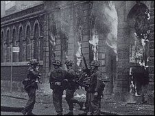 soldiers at a burning building