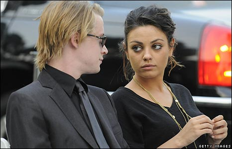 Macaulay Culin with Mila Kunis
