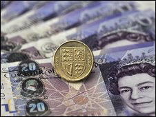 Notes and pound coin