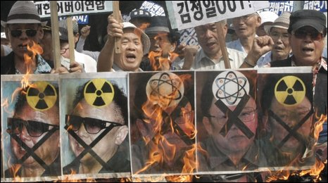Protestors in the South Korean capital, Seoul, burn banners of Kim Yong-il after Pyongyang's annoucement regarding its uranium enrichement programme