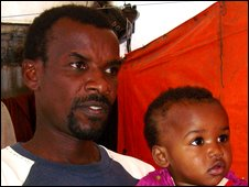 Ali Ja'far, a 42 year old Zanzibari, with one of his children