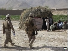 Nato soldiers approach an Afghan family