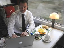 Businessman working on a laptop on the train