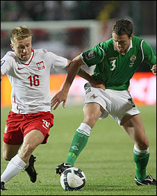 Jakub Blaszczykowski of Poland in action against Northern Ireland's Jonny Evans