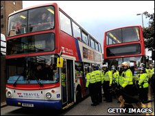 Protesters on buses in Birmingham, surrounded by police