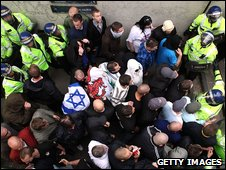 English Defence League protesters are coralled by police in a subway during the rally