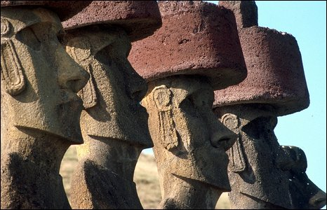 The ancient statues have giant red hats (BBC)