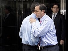 Men hug outside Lehman Brothers