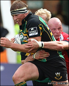 Saints captain Dylan Hartley charges into the Worcester defence