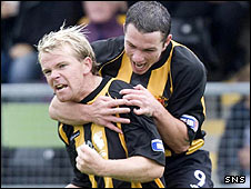 Bryan Gilfinnan and David Cox celebrate