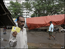 A fisherman in Mumbai with an identity card