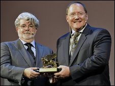 Star Wars creator George Lucas presents Pixar's John Lasseter with the award