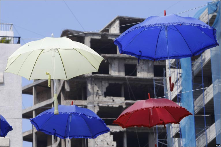 umbrellas adoring the street