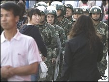 Chinese paramilitary police patrol central Urumqi on 7/10/09