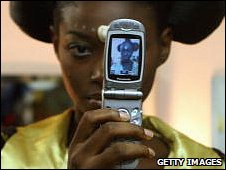 Nigerian model with cell phone
