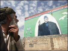 An Afghan man looks at an election billboard of Afghan President Hamid Karzai in Kabul on 31 August 2009