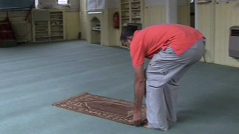 Man with prayer mat