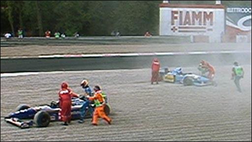 Michael Schumacher goes to accost Damon Hill