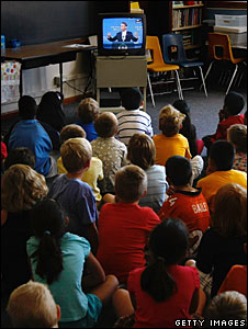 Schoolchildren watch US President Barack Obama deliver his speech on television