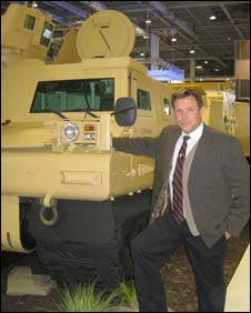 Major (rtd) Jez Hermer with a Warthog armoured vehicle