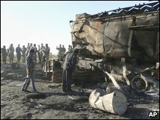 The two burned out tankers in Kunduz, pictured on 5 September 2009, the day Farrell and Mr Munadi were abducted