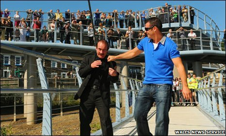 Enzo and Joe Calzaghe on the bridge named after them in Newbridge