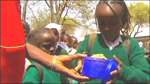 Child getting school food in Kenya
