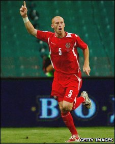 James Collins celebrates scoring Wales' equaliser against Russia