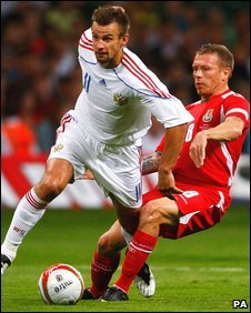 Russia's Sergei Semak tussles with Wales captain Craig Bellamy