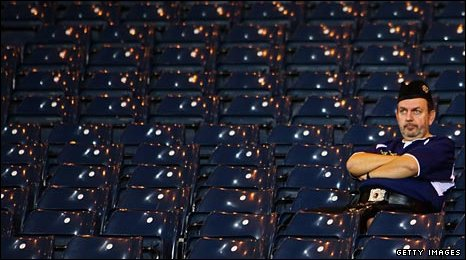 A lone Scotland fan contemplates the end of a World Cup dream