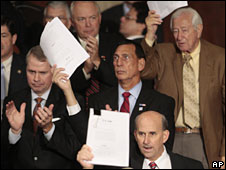 Republican House members wave papers as President Barack Obama delivers a speech on healthcare to a joint session of Congress, 9 September 2009