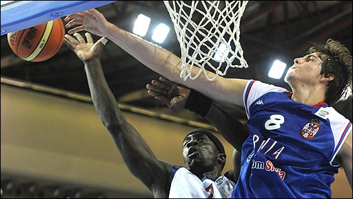 GB's Pops Mensah-Bonsu is challenged by Serbia's Nemanja Bjelica